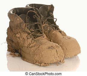 泥だらけである, 作業用のブーツ