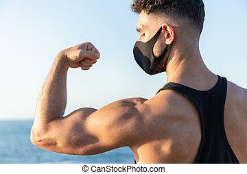 coronavirus, 人, 二頭筋, covid-19, 概念, に対して, 提示, コーカサス人, 戦い, マスク, バックグラウンド。, 彼の, 身に着けていること, 顔, 青, 運動, 空